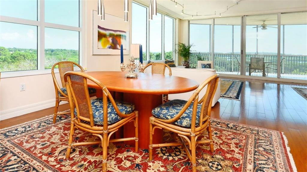 Dining Room - Condo for sale at 409 N Point Rd #601, Osprey, FL 34229 - MLS Number is A4189564