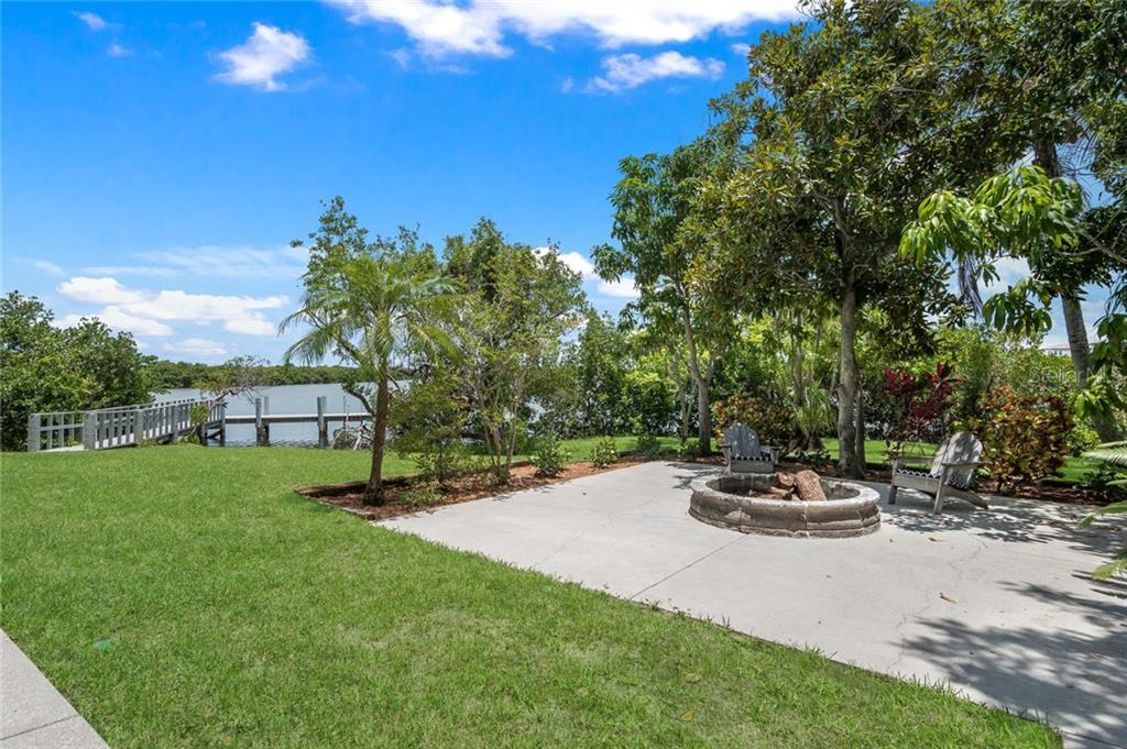 back yard with large paved lanai and fire pit - Single Family Home for sale at 2560 Tarpon Rd, Palmetto, FL 34221 - MLS Number is A4189616