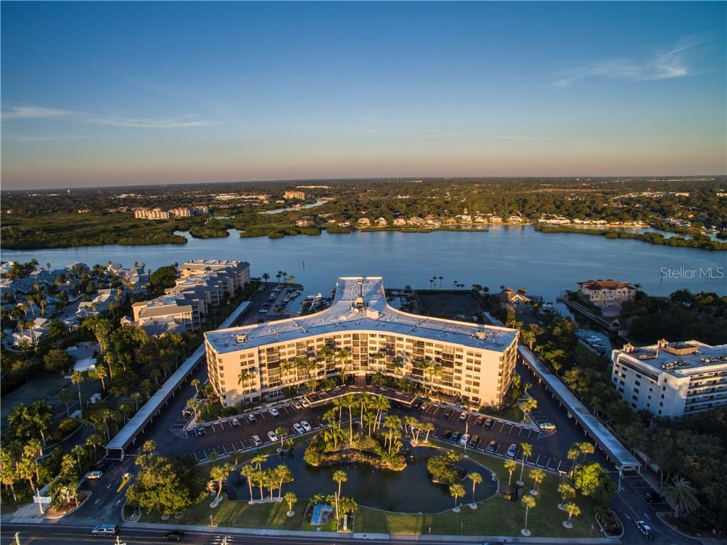 Sunset aerial view looking east - Condo for sale at 5855 Midnight Pass Rd #628, Sarasota, FL 34242 - MLS Number is A4190416