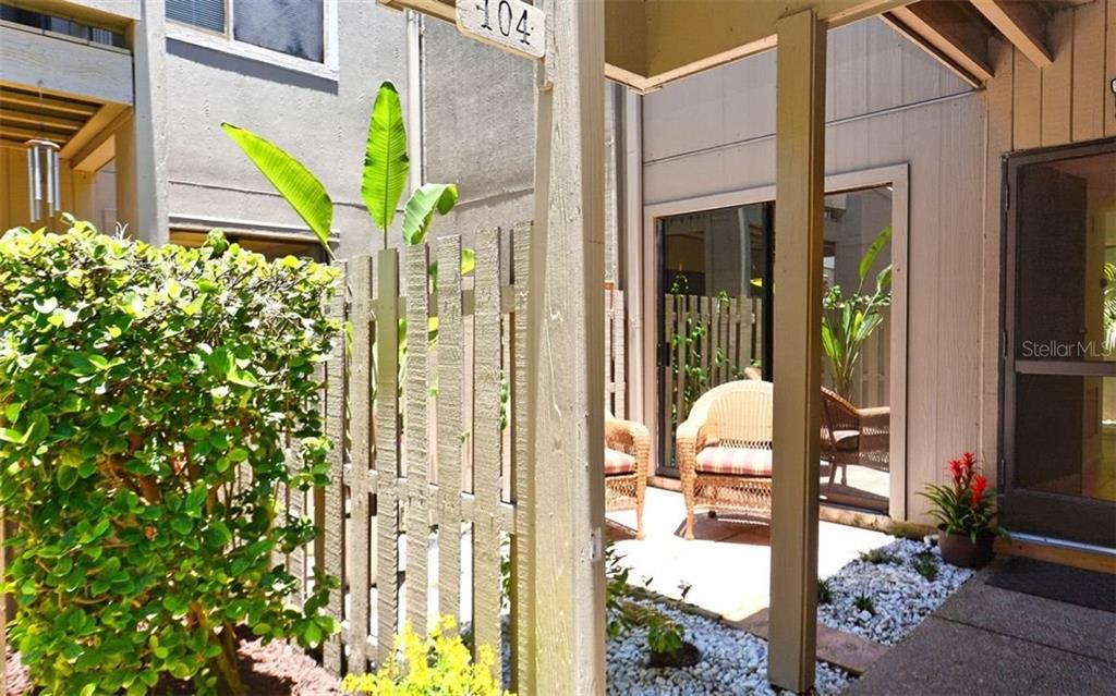 Gated fenced patio entry - Condo for sale at 104 Woodland Pl #104, Osprey, FL 34229 - MLS Number is A4190676