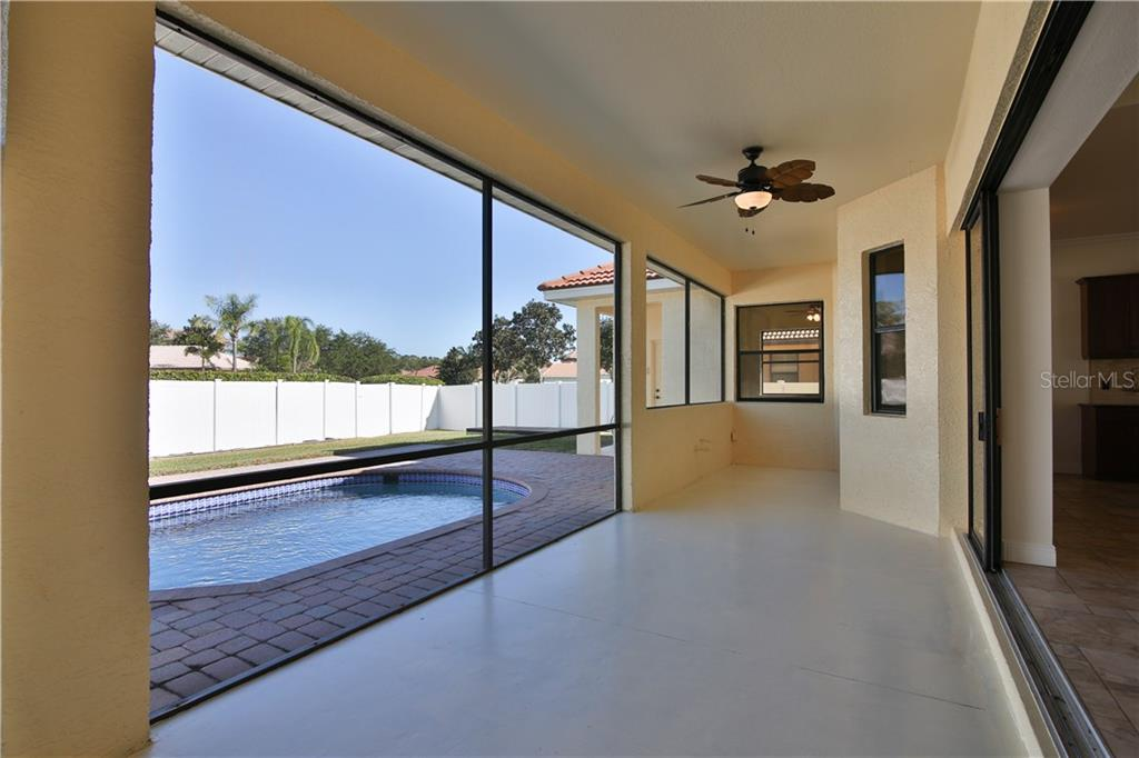 Dine and relax in the covered lanai area - Single Family Home for sale at 7662 Trillium Blvd, Sarasota, FL 34241 - MLS Number is A4190704