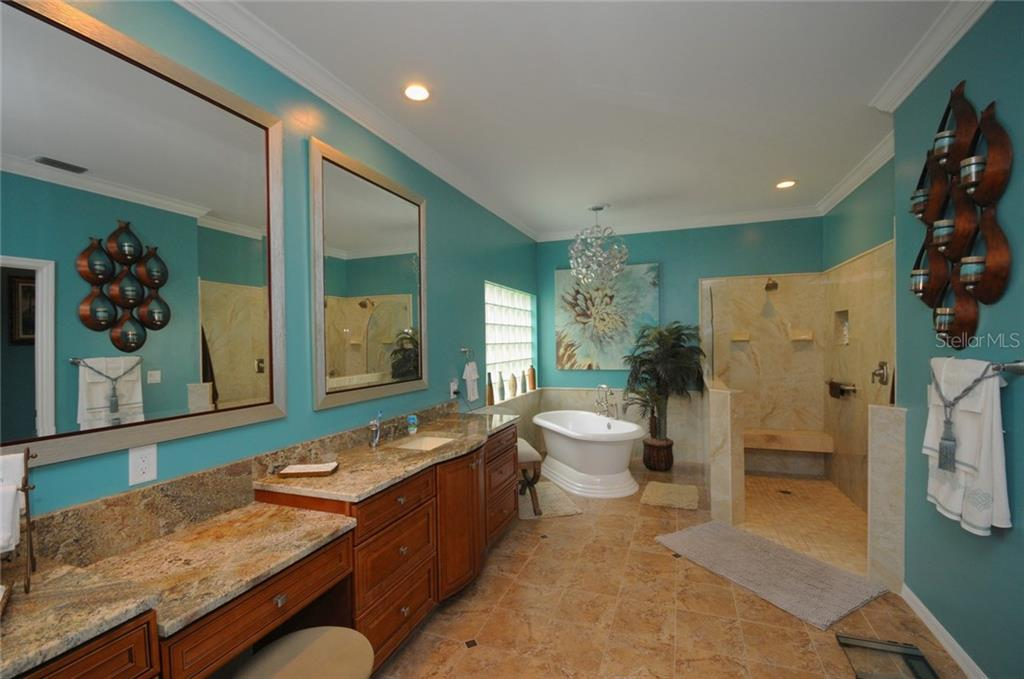 Master bathroom with double vanities, tub and walk-in shower - Villa for sale at 7707 Calle Facil, Sarasota, FL 34238 - MLS Number is A4191635