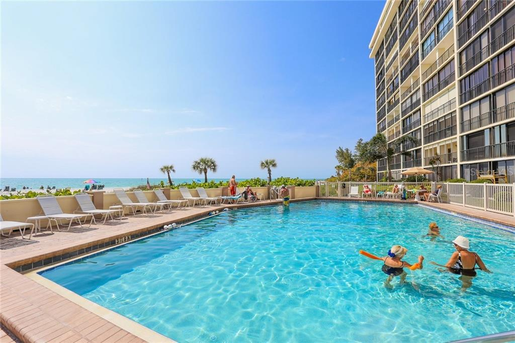 Swimming pool and sun deck - Condo for sale at 20 Whispering Sands Dr #1103, Sarasota, FL 34242 - MLS Number is A4192663