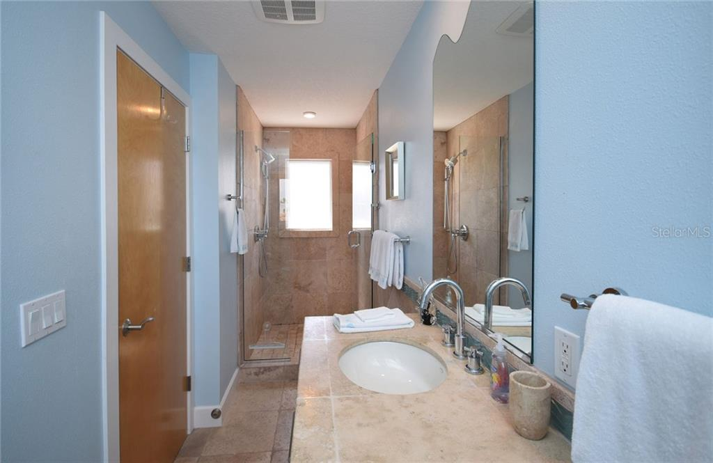Another view of 2nd bath with walk in shower. Stone counters and tile. - Condo for sale at 439 Beach Rd #e, Sarasota, FL 34242 - MLS Number is A4192797