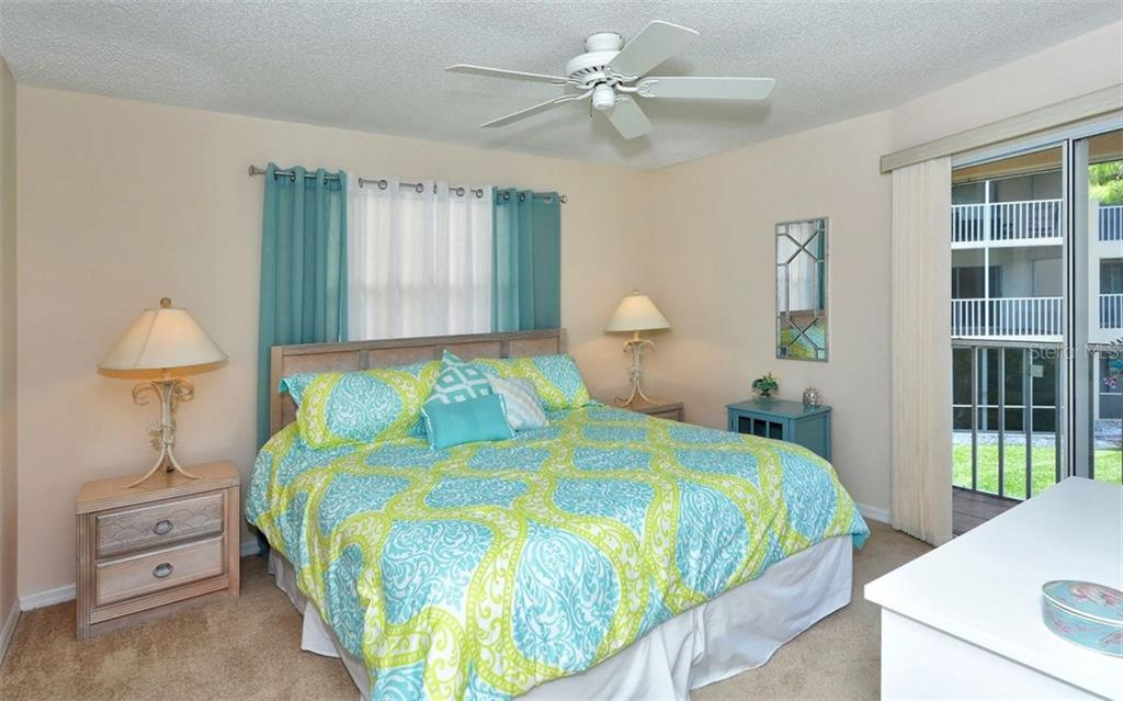 Bright and light side window adds sunshine to this end unit condo. - Condo for sale at 9300 Clubside Cir #1201, Sarasota, FL 34238 - MLS Number is A4192821