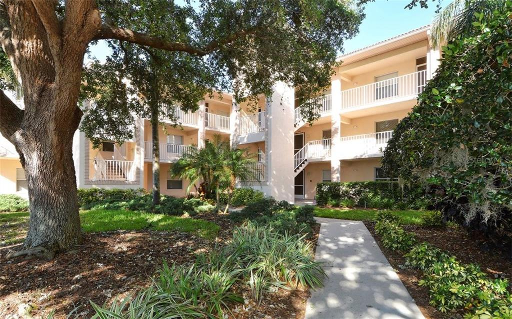 Front entrance to the Clubside I complex.  Unit is to the left 2nd floor. - Condo for sale at 9300 Clubside Cir #1201, Sarasota, FL 34238 - MLS Number is A4192821