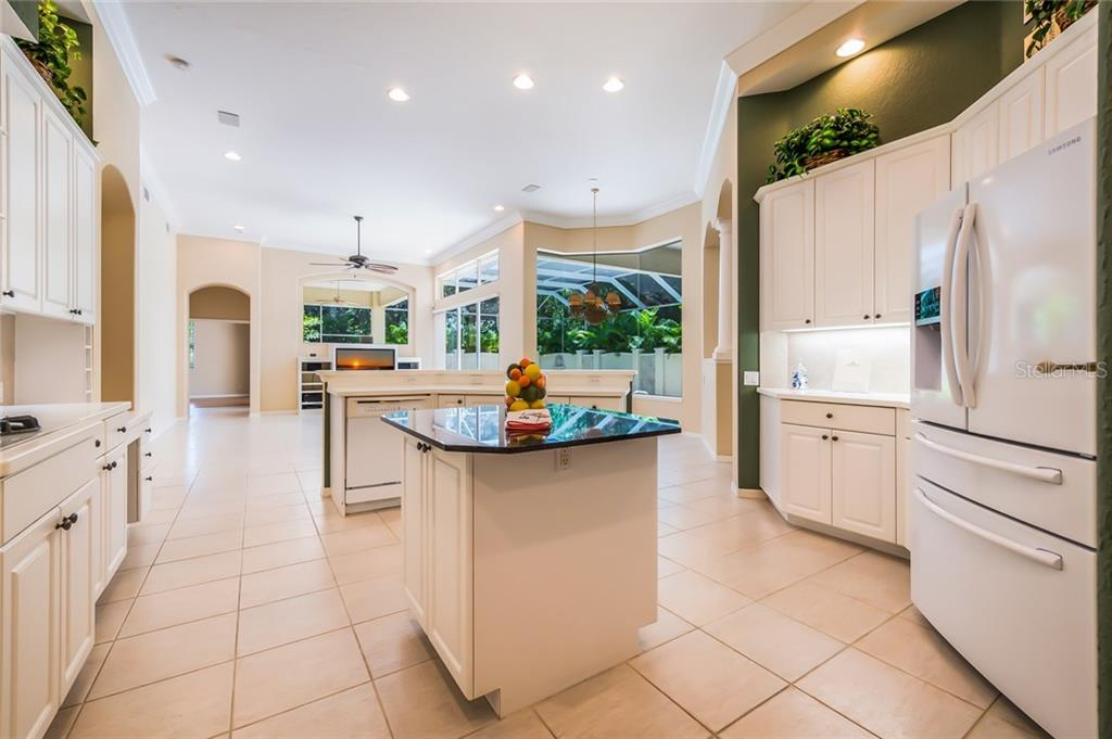A center island; new refrigerator and white kitchens are trending now! - Single Family Home for sale at 8019 Collingwood Ct, University Park, FL 34201 - MLS Number is A4193802
