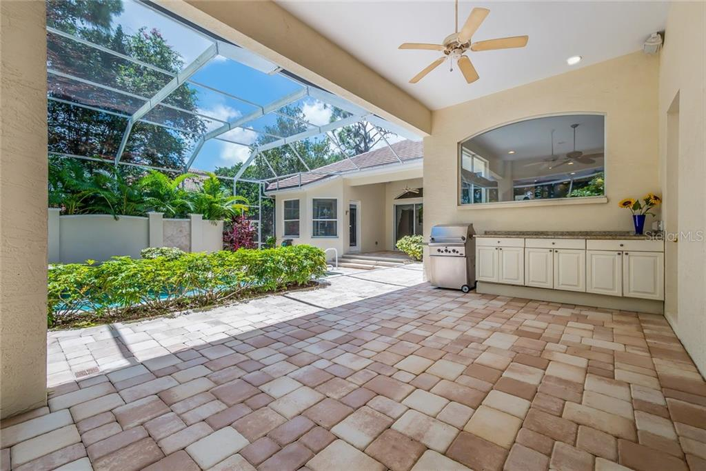 Outdoor dining area.  Free standing natural gas grill with hook-up.  Granite tops. - Single Family Home for sale at 8019 Collingwood Ct, University Park, FL 34201 - MLS Number is A4193802