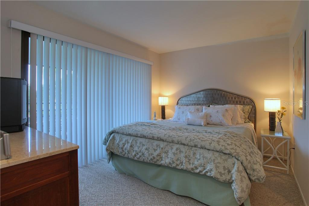 Lovely Guest house bedroom with access to a private screened balcony. - Single Family Home for sale at 4831 Hoyer Dr, Sarasota, FL 34241 - MLS Number is A4195351