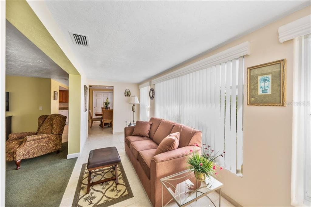 Enclosed lanai - Condo for sale at 6140 Midnight Pass Rd #c-9, Sarasota, FL 34242 - MLS Number is A4195879