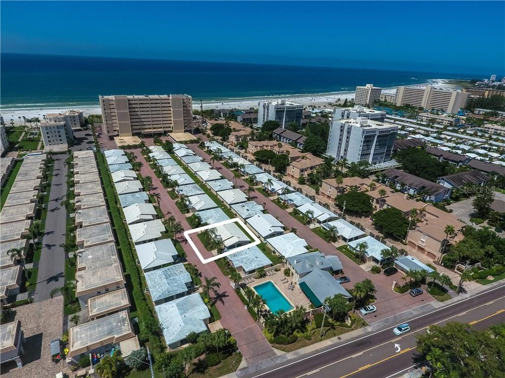 Aerial view looking towards Gulf of Mexico - Condo for sale at 6140 Midnight Pass Rd #c-9, Sarasota, FL 34242 - MLS Number is A4195879
