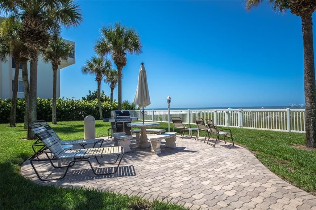 Community gulf side BBQ patio - Condo for sale at 6140 Midnight Pass Rd #c-9, Sarasota, FL 34242 - MLS Number is A4195879