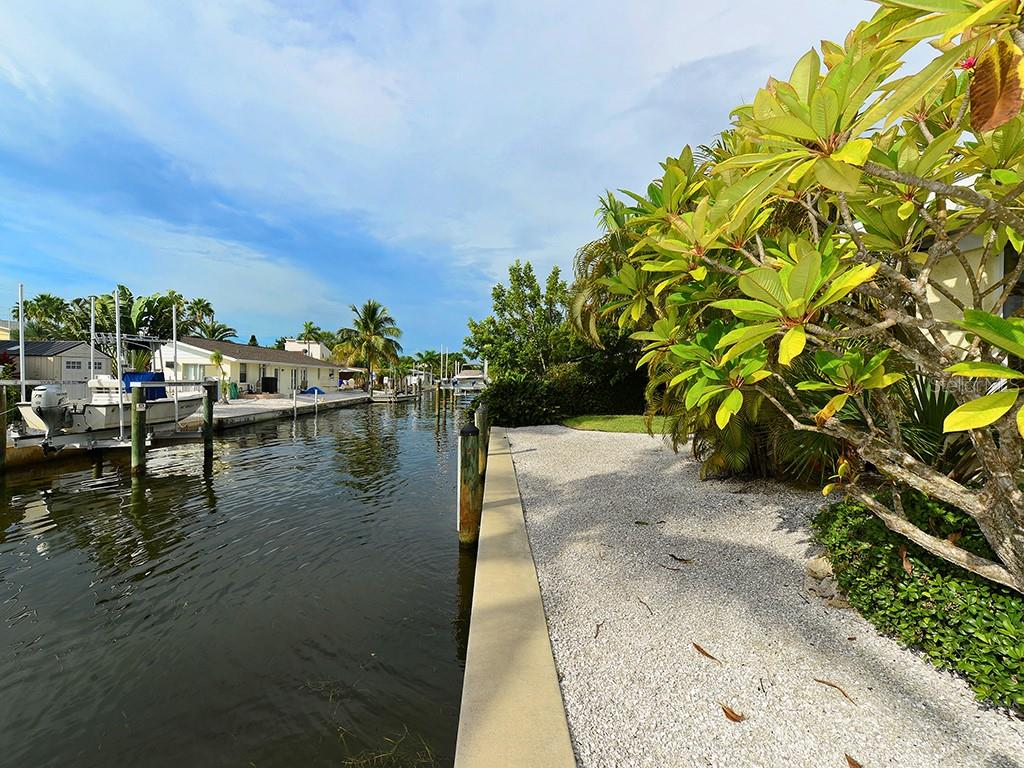 Waterway - Single Family Home for sale at 726 Jungle Queen Way, Longboat Key, FL 34228 - MLS Number is A4196293