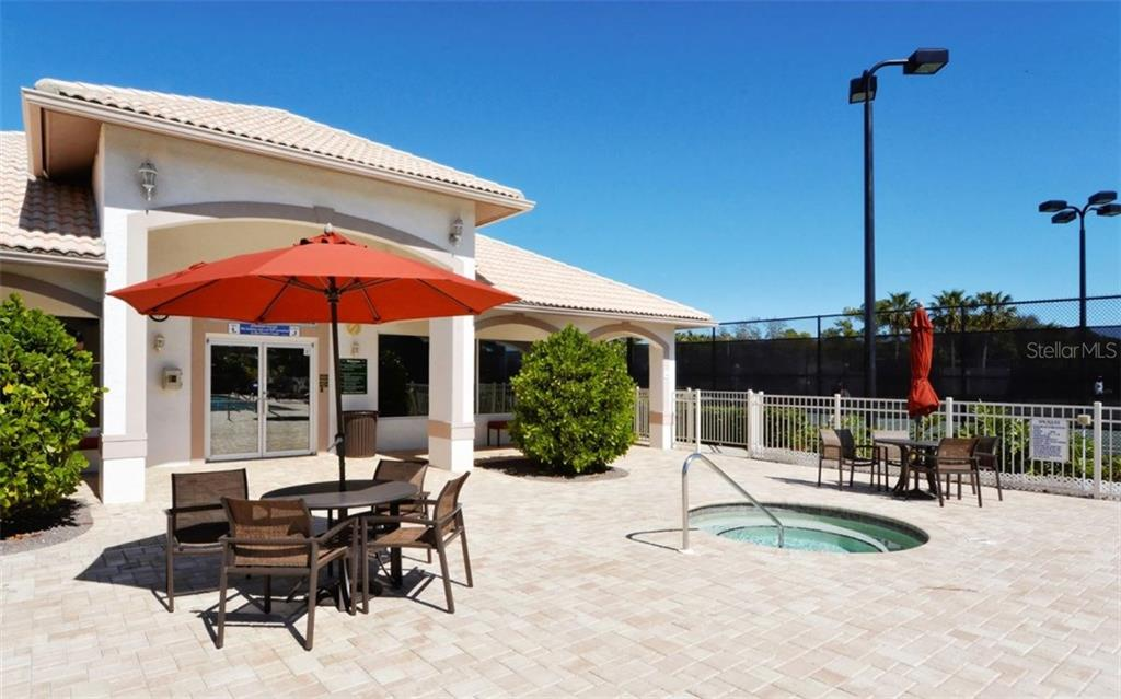 Stoneybrook Golf & Country Club fitness center and pool deck. Lighted har-tru tennis courts to the right. - Condo for sale at 9570 High Gate Dr #1712, Sarasota, FL 34238 - MLS Number is A4196327