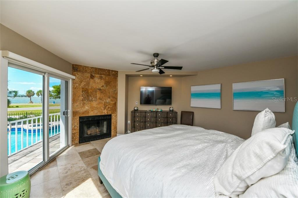 Master suite with wood burning fireplace. - Single Family Home for sale at 105 Seagull Ln, Sarasota, FL 34236 - MLS Number is A4197600