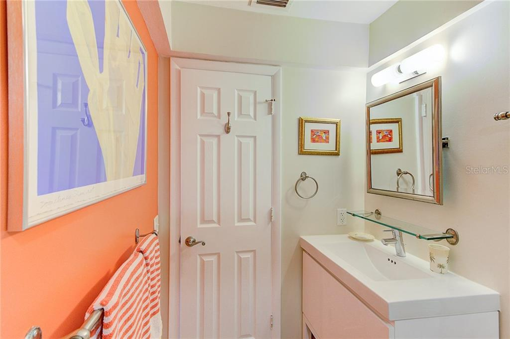 Updated bathroom with shower bench and designer vanity - Condo for sale at 600 Manatee Ave #236, Holmes Beach, FL 34217 - MLS Number is A4197636