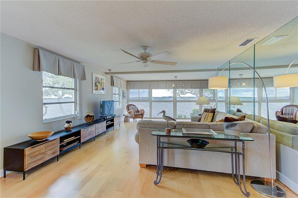 Serene water views from every angle in this open living room - Condo for sale at 600 Manatee Ave #236, Holmes Beach, FL 34217 - MLS Number is A4197636