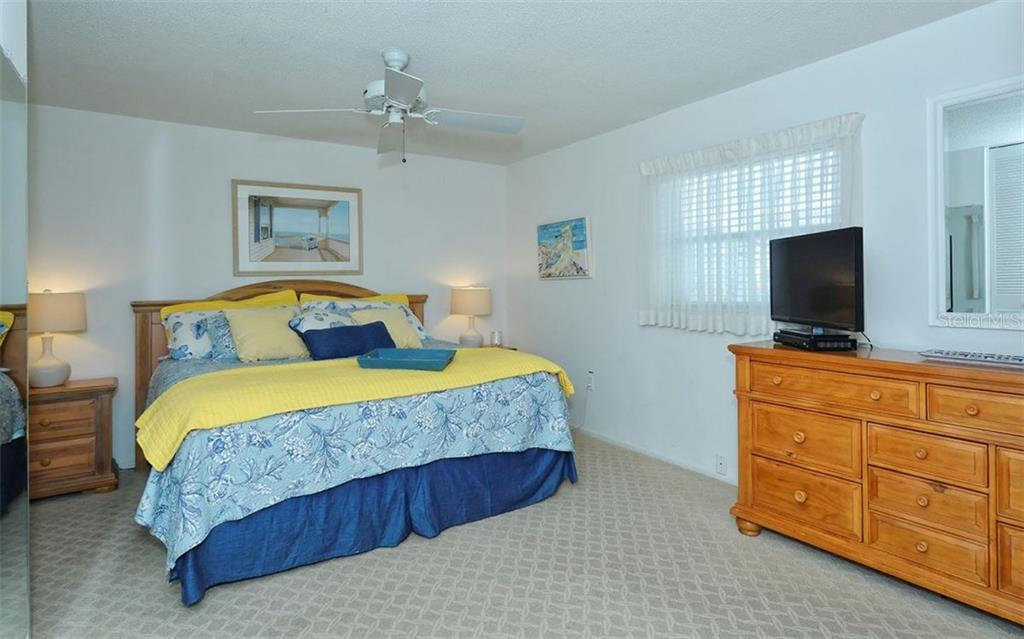 Master bedroom - Single Family Home for sale at 6308 Midnight Pass Rd #4, Sarasota, FL 34242 - MLS Number is A4198360