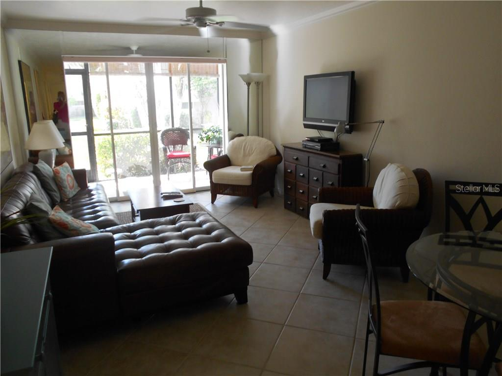 Living/Dining room with sliders to covered lanai - Condo for sale at 5661 Midnight Pass Rd #403, Sarasota, FL 34242 - MLS Number is A4198451