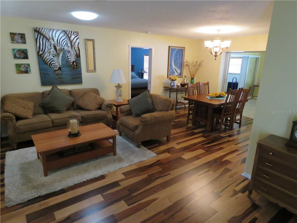 View of living room and dining room as your enter your home.  Brazilian Pecan hardwood floors are present throughout most of house. - Single Family Home for sale at 829 Harbor Dr S, Venice, FL 34285 - MLS Number is A4198898