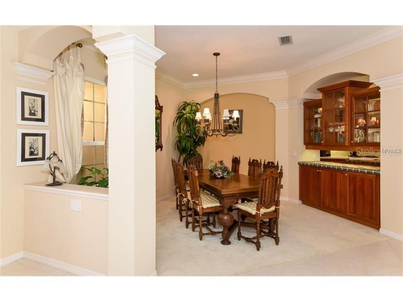 Open Dining Area With A Pass Through To The Kitchen! - Single Family Home for sale at 6910 Treymore Ct, Sarasota, FL 34243 - MLS Number is A4198957