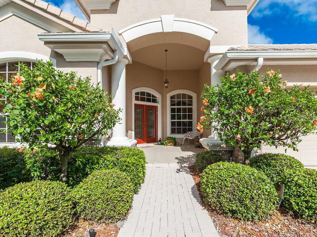 Paver drive and walkway lead to impressive entry. - Single Family Home for sale at 4887 Carrington Cir, Sarasota, FL 34243 - MLS Number is A4199511