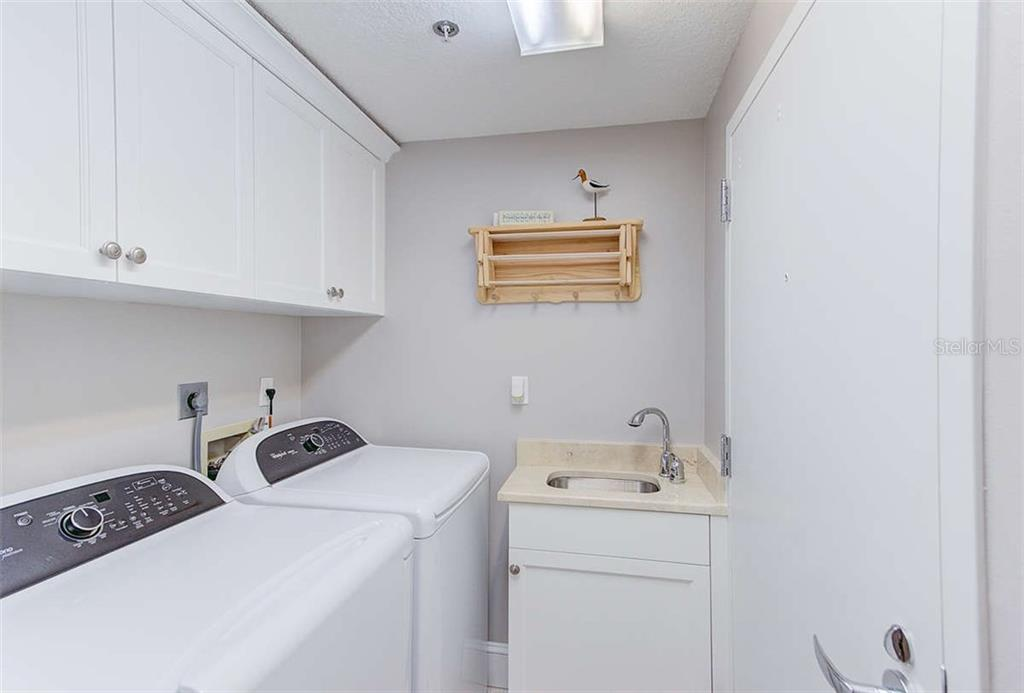 Laundry w/Custom Cabinetry - Condo for sale at 3060 Grand Bay Blvd #142, Longboat Key, FL 34228 - MLS Number is A4199568
