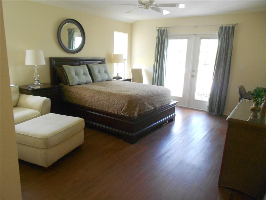 Master Suite with French Doors leading to the built-in Spa on Screened Lanai - Single Family Home for sale at 6320 Hera St, Englewood, FL 34224 - MLS Number is A4200968