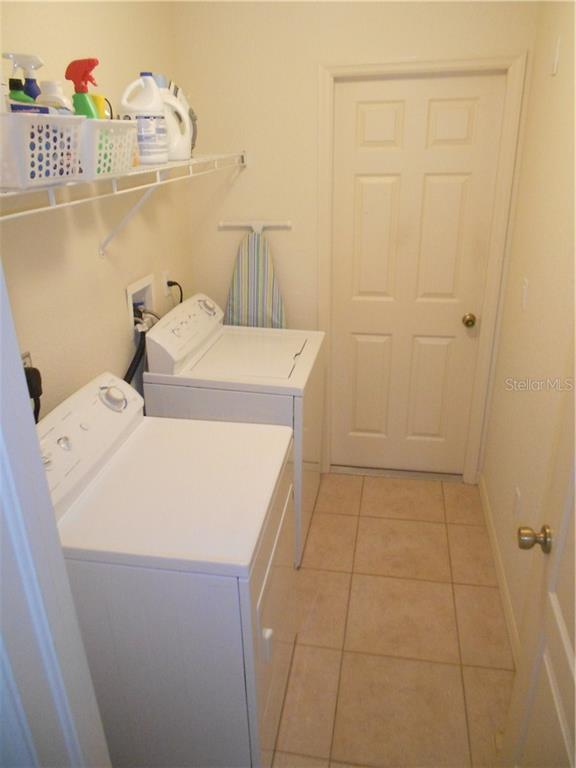 Inside Laundry Room with access to Garage - Single Family Home for sale at 6320 Hera St, Englewood, FL 34224 - MLS Number is A4200968