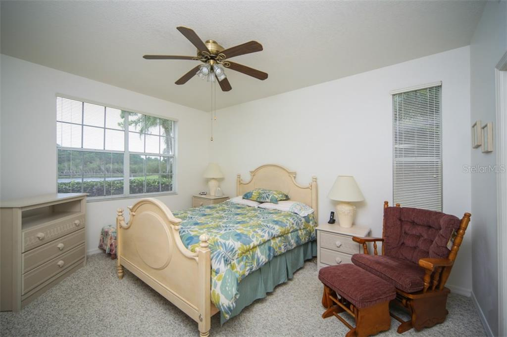 Master bedroom with view of Crockers Lake - Condo for sale at 8390 Wingate Dr #517, Sarasota, FL 34238 - MLS Number is A4201592