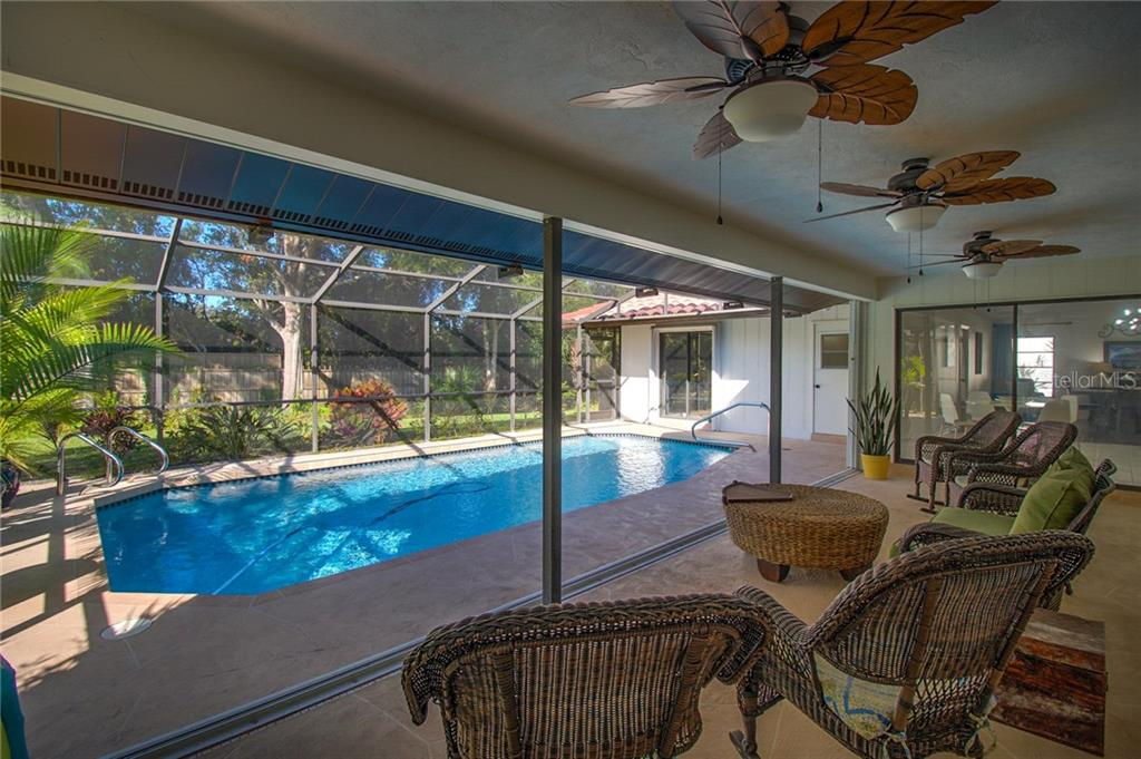 Covered Patio Overlooking Salt Water Pool and Back Yard - Single Family Home for sale at 1087 Hoover Cir, Nokomis, FL 34275 - MLS Number is A4201722