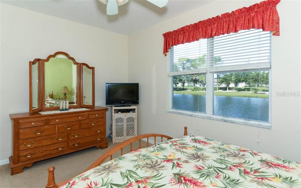 Master Suite Offers Water Views When You Awake in the Morning! - Condo for sale at 5280 Hyland Hills Ave #1814, Sarasota, FL 34241 - MLS Number is A4202373