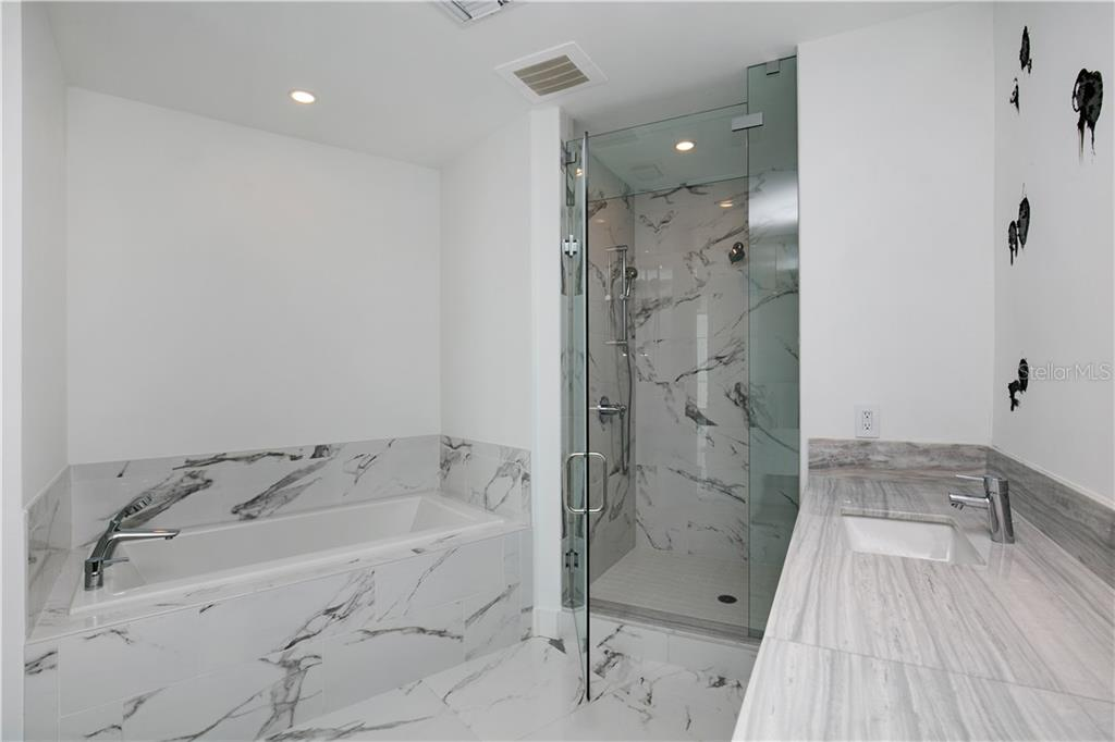 Master bathroom with walk-in shower - Condo for sale at 1155 N Gulfstream Ave #305, Sarasota, FL 34236 - MLS Number is A4202467