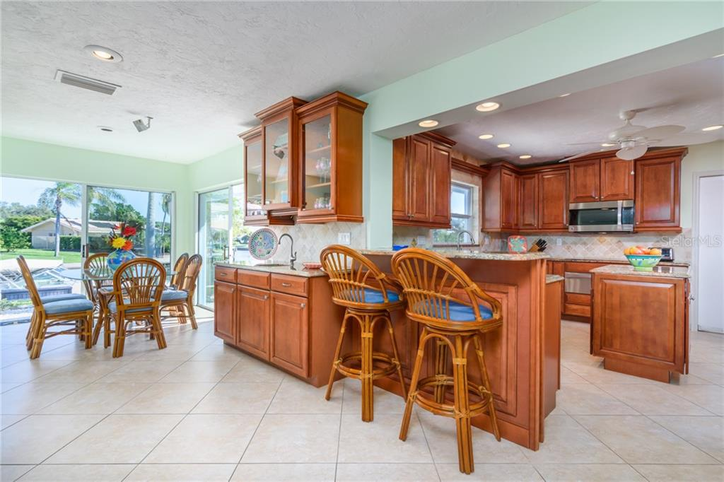 Kitchen and dining area - Single Family Home for sale at 5439 Azure Way, Sarasota, FL 34242 - MLS Number is A4203969