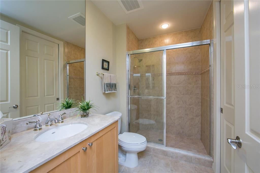 Guest Bathroom #2 with private access to second guest bedroom. - Condo for sale at 3603 N Point Rd #703bd6, Osprey, FL 34229 - MLS Number is A4204172
