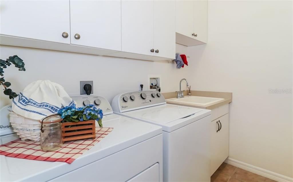Large Laundry Room with Cabinets and Laundry Sink - Single Family Home for sale at 460 Otter Creek Dr, Venice, FL 34292 - MLS Number is A4205372