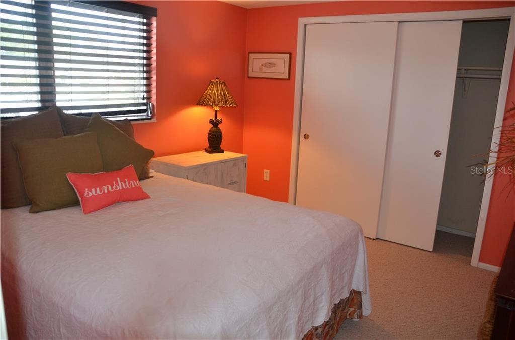 Guest Bedroom: View from Corner of Room: This bright, radiant guest bedroom offers plenty of space for a guest to relax after a long day at Siesta Key Beach! - Villa for sale at 2319 Terry Ln, Sarasota, FL 34231 - MLS Number is A4205590