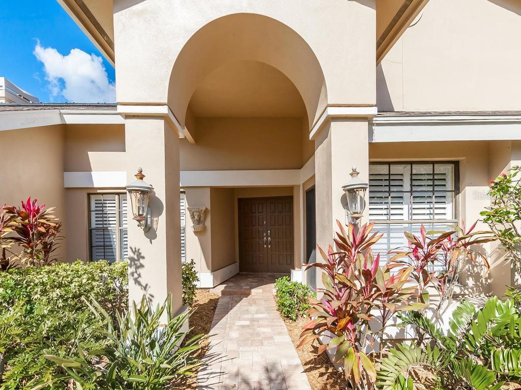 Beautiful architectural details at the entryway - Single Family Home for sale at 3959 Prairie Dunes Dr, Sarasota, FL 34238 - MLS Number is A4205907