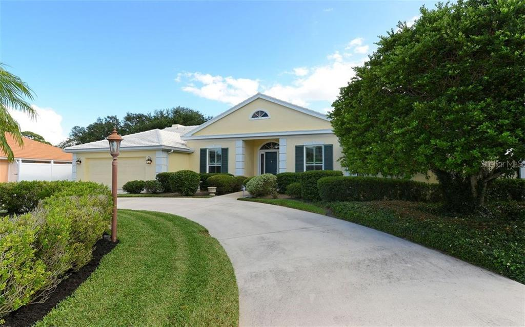 Front of home showing circular drive - Single Family Home for sale at 3882 Spyglass Hill Rd, Sarasota, FL 34238 - MLS Number is A4206477