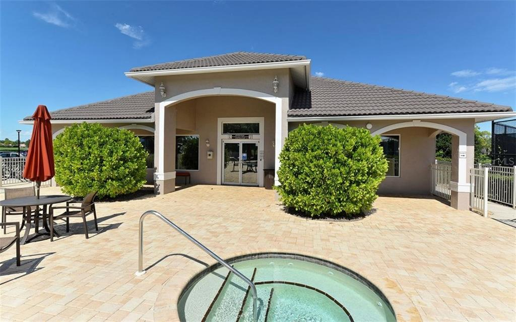Stoneybrook Golf & Country Club fitness center and spa.  Lighted tennis courts are to the right. - Villa for sale at 9554 Forest Hills Cir, Sarasota, FL 34238 - MLS Number is A4206506