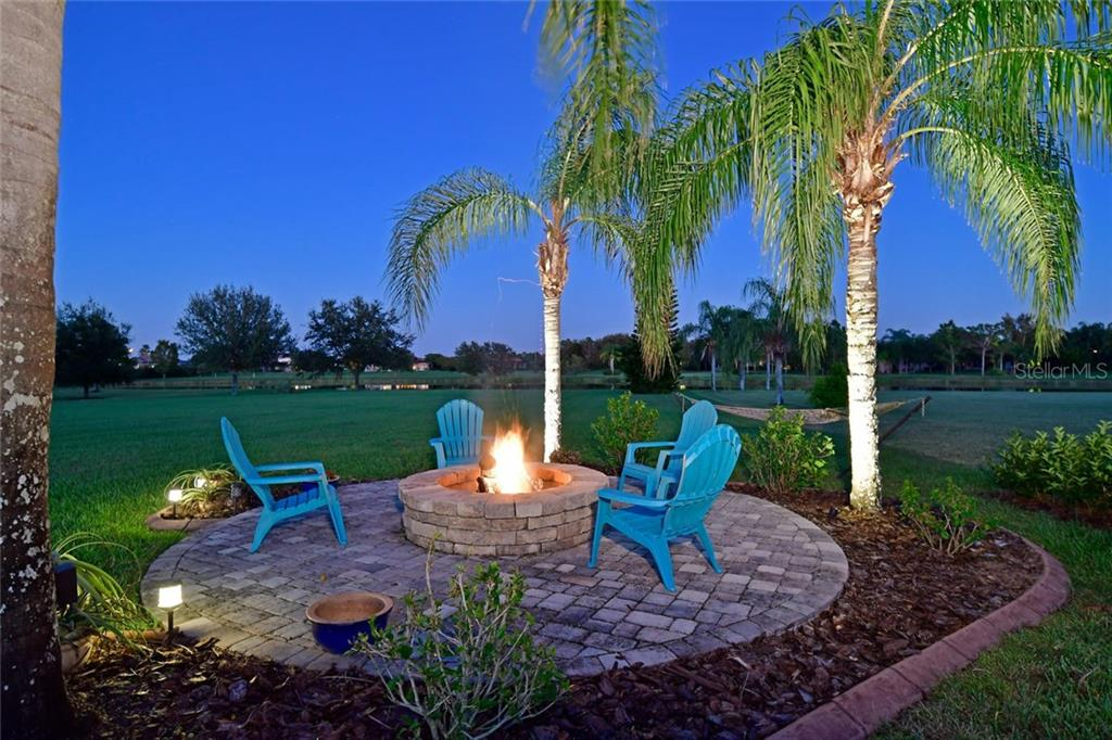 Listen to the the crackling of the firewood, roast marshmallows or relax in your hammock. It's like having a resort in your own backyard! - Single Family Home for sale at 22611 Morning Glory Cir, Bradenton, FL 34202 - MLS Number is A4207071