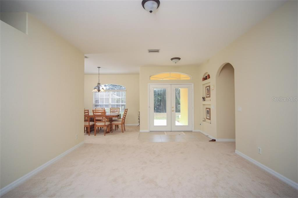 Living/Dining room - Single Family Home for sale at 1876 Bushnell Ave, North Port, FL 34286 - MLS Number is A4207073