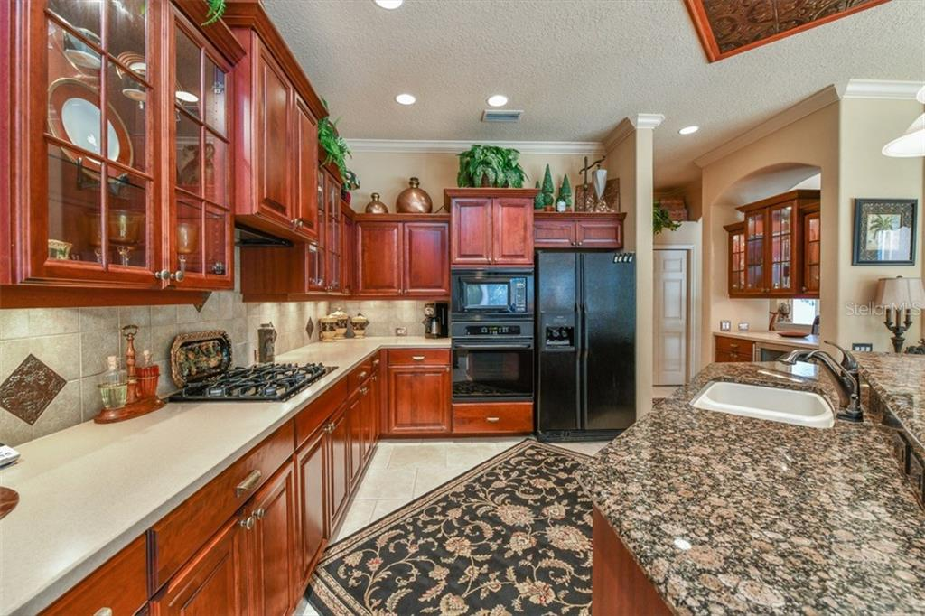 Single Family Home for sale at 6914 Treymore Ct, Sarasota, FL 34243 - MLS Number is A4207152