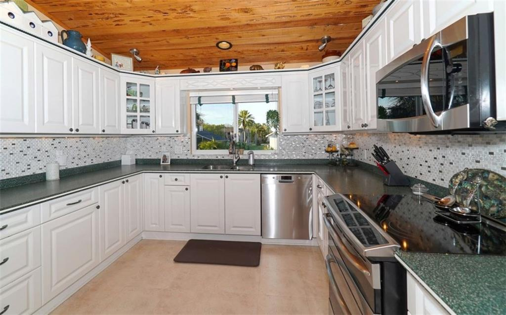 Kitchen features newer stainless appliances, corian counters. - Single Family Home for sale at 3908 Bayside Dr, Bradenton, FL 34210 - MLS Number is A4207355