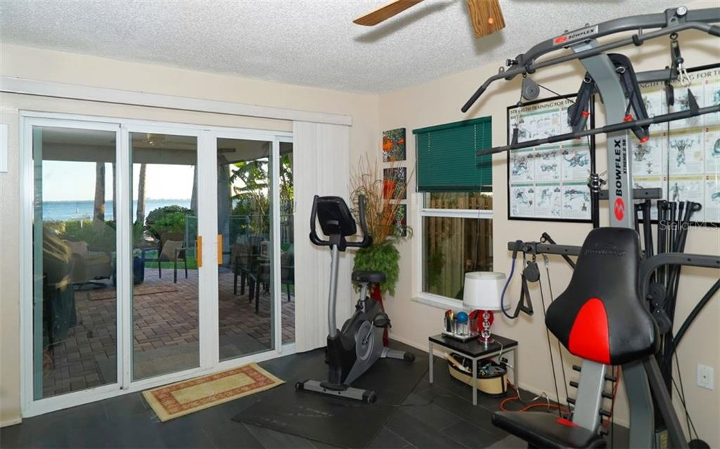 Downstairs room used as a gym. - Single Family Home for sale at 3908 Bayside Dr, Bradenton, FL 34210 - MLS Number is A4207355