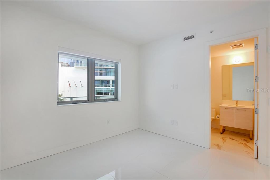 2nd bedroom with en suite bathroom - Condo for sale at 1155 N Gulfstream Ave #304, Sarasota, FL 34236 - MLS Number is A4208934