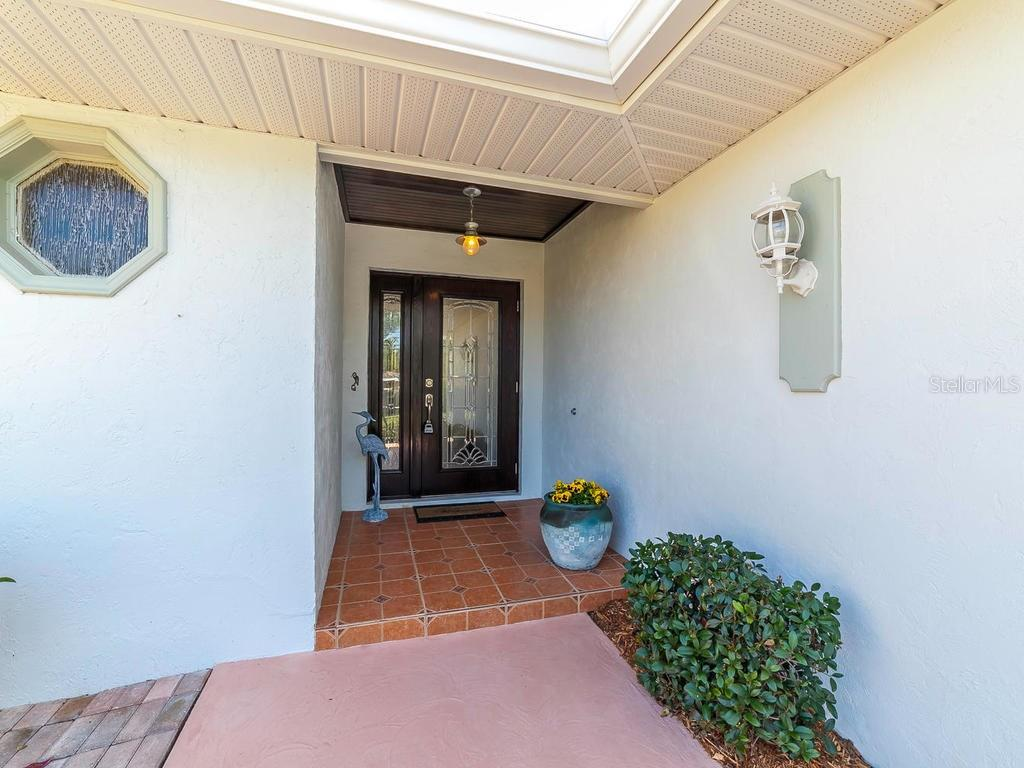 Front Entry - Single Family Home for sale at 411 Lyons Bay Rd, Nokomis, FL 34275 - MLS Number is A4209146