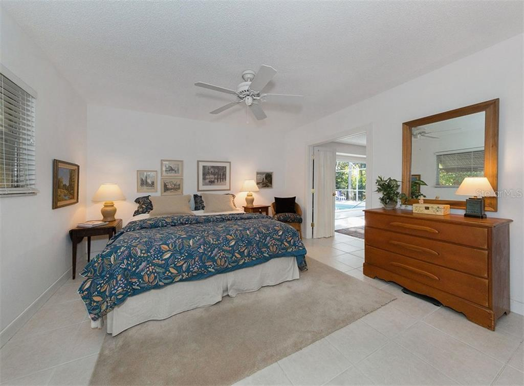 Master bedroom with sliders to pool - Single Family Home for sale at 445 Mahon Dr, Venice, FL 34285 - MLS Number is A4209507