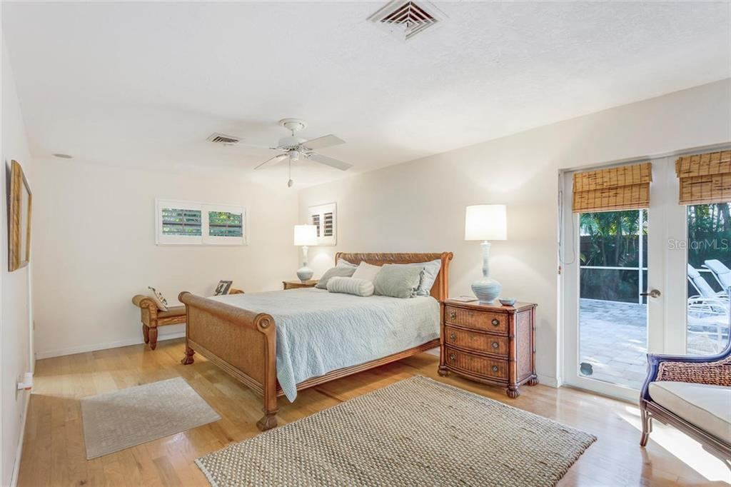 Master bedroom with French doors to lanai - Single Family Home for sale at 5634 Cape Leyte Dr, Sarasota, FL 34242 - MLS Number is A4209556