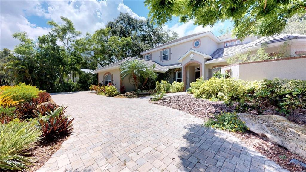Cozy Gas fireplace on covered lanai, just outside private French door entrance to Master Bedroom..with heated pool and spa right there as well. - Single Family Home for sale at 1874 Oleander St, Sarasota, FL 34239 - MLS Number is A4209954